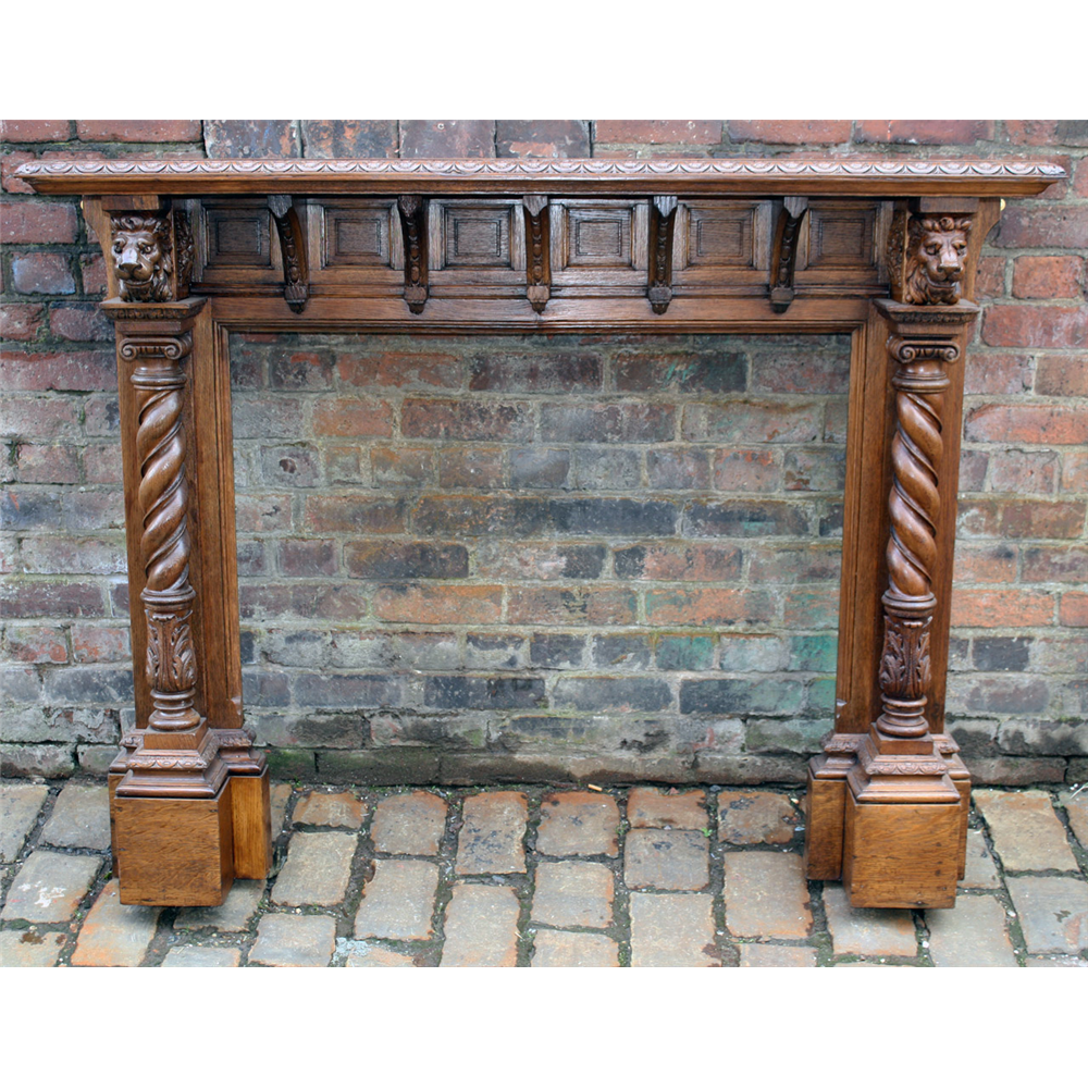 Antique Carved Oak Fire Surround With Lion Capitals